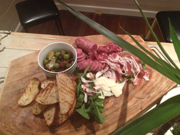 Cured pork products, marinated olives, radishes from the garden and some grilled bread is a damn fine way to start a meal