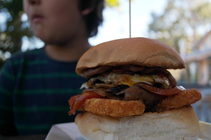 The boys had the breakky burger; bacon, egg, hashbrowns, sausage, mushroom & onion. The look on Sebas face says it all...