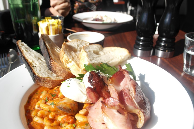 Farmgate Cassoulet: Sausages and cannellini beans braised in tomato   and served with poached eggs and fresh sourdough 21.00. Side of local bacon 3.00. Mmmmm