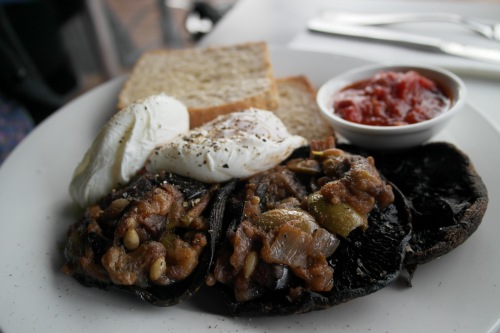 Poached eggs with arrabiatta salsa , side of mushrooms with caponata
