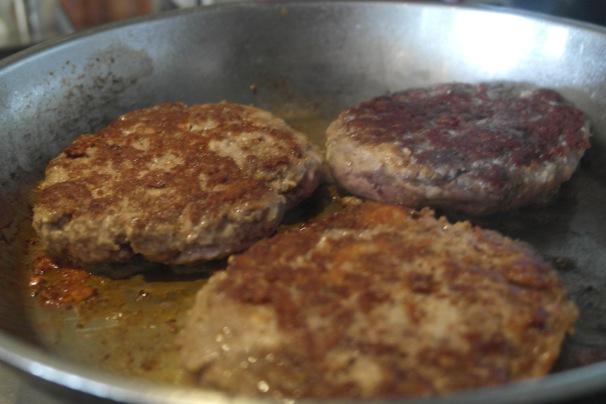 Burgers cooking. Big burgers
