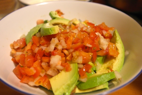 Tha avocado and tomato salad. Dressed with a little red wine vinegar, seasoning and olive oil