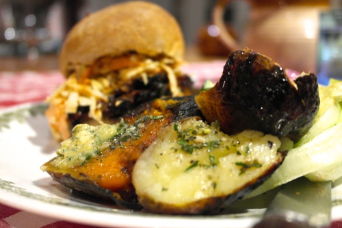 Brisket and coleslaw roll with garlic butter potatoes from the coals