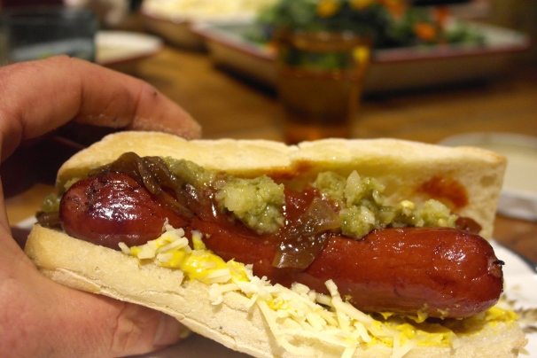 Smoked sausage, sauerkraut, caramelised onion, mustard, tomato relish, jalapeño relish and gruyere cheese, in a roll and about to make it's way into my belly