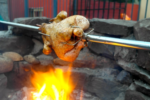 The chicken, the spit, the fire pit, the love