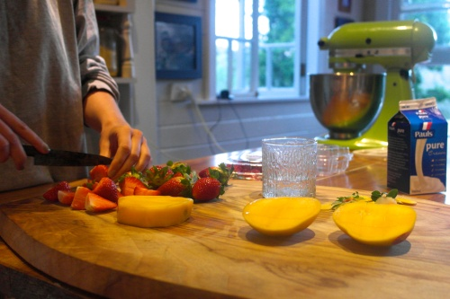 Amelia's hands getting dessert ready. Don't be fooled by all of that fruit… this was not a trendy new age raw fruit cake