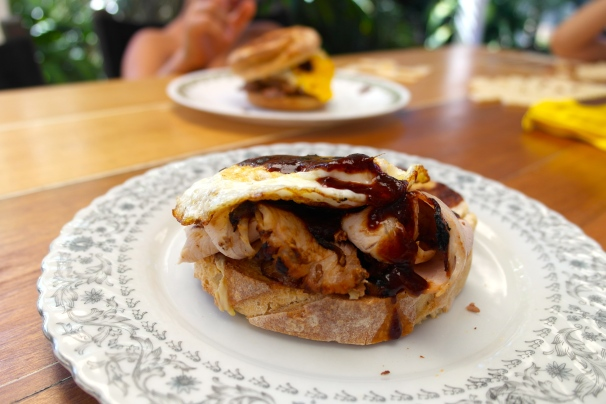 Smoked pork, egg and brown sauce sandwich for breakfast. Oh dear good lord this was the business