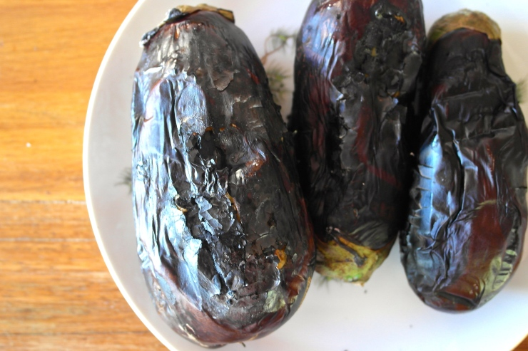 Grill the eggplant over an open flame so it gets all black and delicious looking