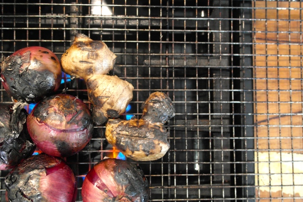 Charring the onions and ginger. A cake rack over a flame works a treat