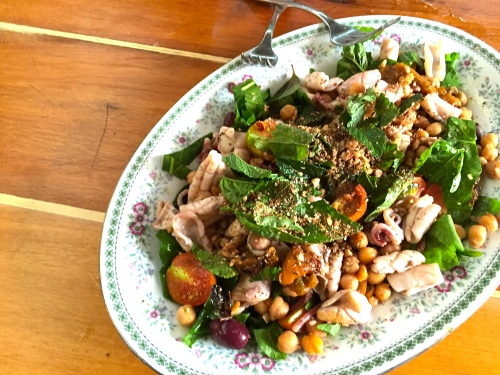 warm salad of squid, chickpeas, olives, tomato, herbs and nutty za'atar
