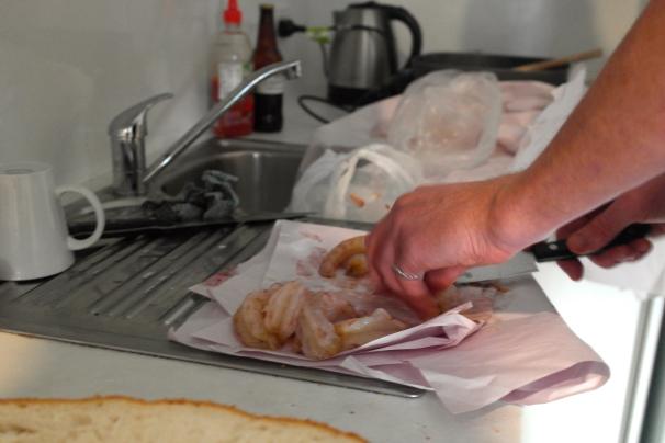 Clean prawns in the little kitchen
