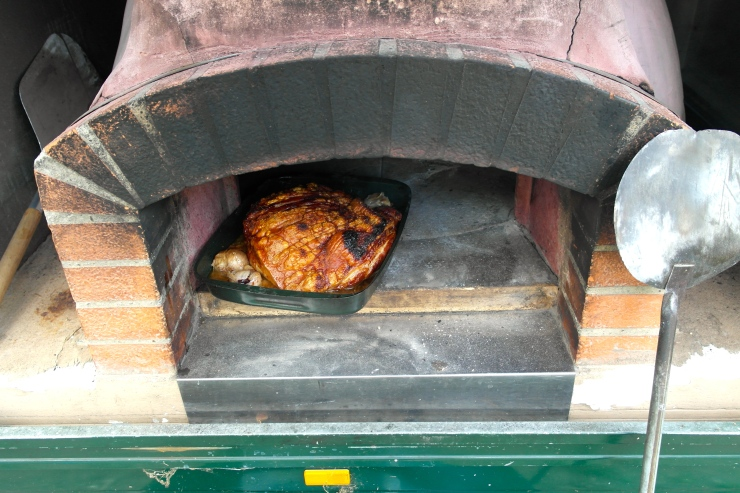 The porky coming out of the pizza oven
