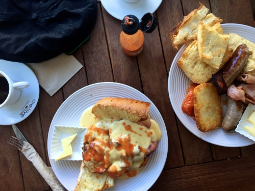 Breakfast at Poboy Cajun and Creole. The farmers breakfast (right) with oven roasted chicken breast, tomatoes, bacon and mornay sauce had me looking for a suitable park bench to nap on