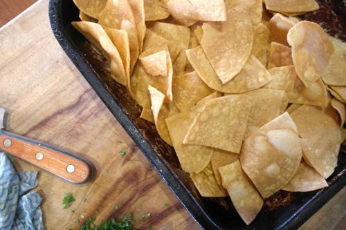 Fry or oven bake some tortilla crisps