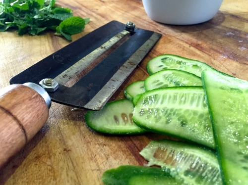The cucumber is best if it's sliced with the same type of hand held double mandoline thingy that is used all over the streets of Vietnam. This invention would've charged a few finger tips for sure...