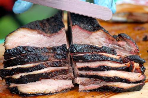 Slice it up so many people may partake in the smoky briskety goodness