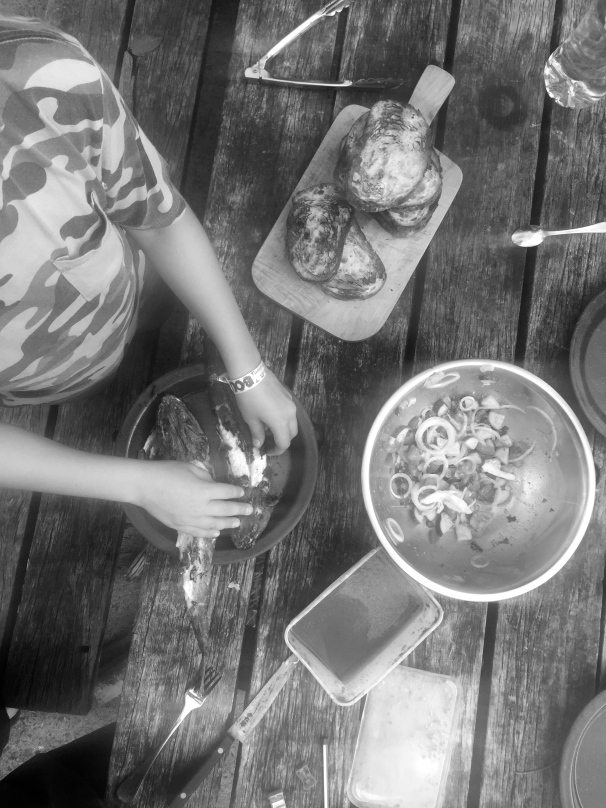 Get one of the kids to prep the fish. Try and disguise your shitty photo by making it black and white