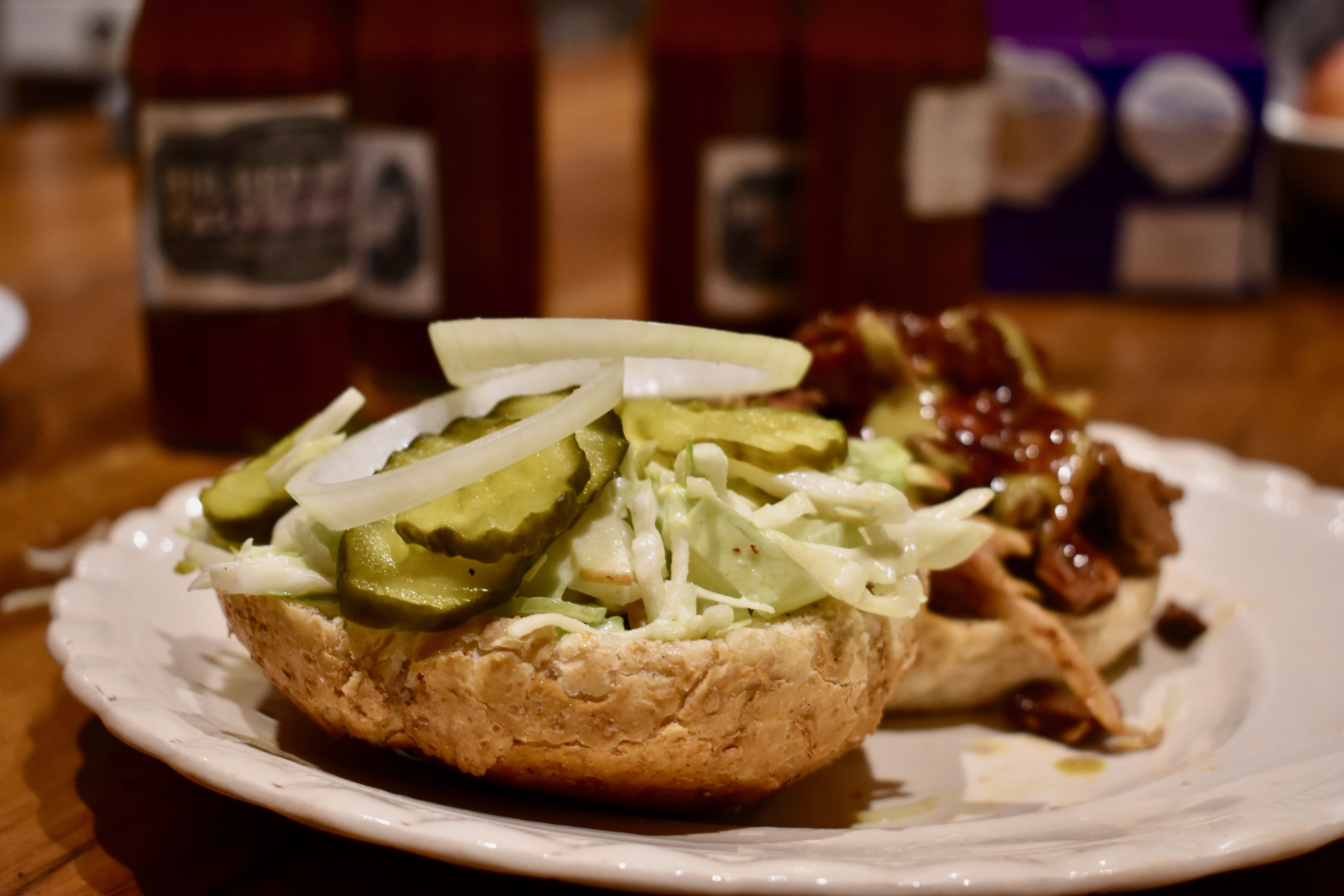 pulled pork burgers with celery and apple slaw